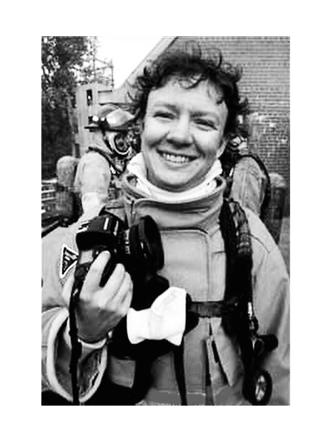 Malinda Hartong, news photographer in fire gear with camera, photojournalist