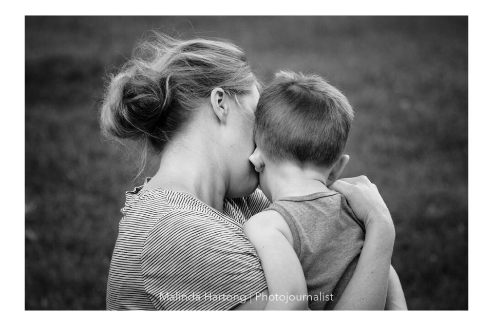 mother son candid moment hug