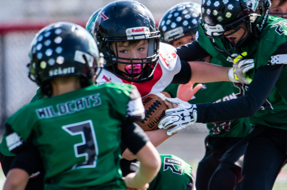 kids play peewee football championship game